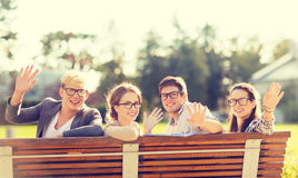 Group of students or teenagers waving hands Stock Photo