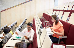 Group of students with tests at lecture hall Stock Image