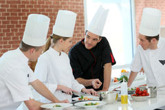 Group of students in training cooking course Stock Photos