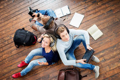 Group of students using smartphones and tablets Stock Photo