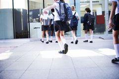 Group of students walking at school Royalty Free Stock Image