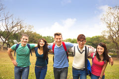 group of students walking together Stock Photo