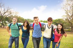 Group of students walking together Royalty Free Stock Images