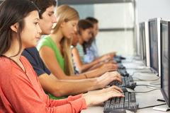 Group Of Students Working At Computers In Classroom Royalty Free Stock Photo