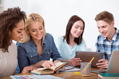 Group of students working in the library Stock Photo