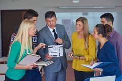 Group of students working with teacher on  house model Royalty Free Stock Images