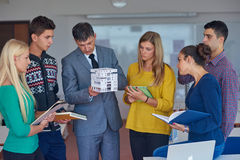 Group of students working with teacher on  house model Stock Photography