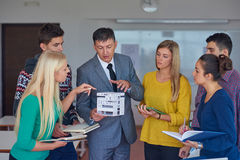 Group of students working with teacher on  house model Stock Images