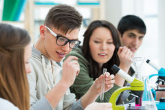 Group of students working together at laboratory Royalty Free Stock Images