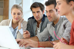 Group of students working together on laptop Royalty Free Stock Photography