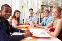 Group Of Students Working Together In Library With Teacher Royalty Free Stock Photo