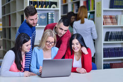 Group Of Students Working Together In Library With Teacher.  Royalty Free Stock Photo