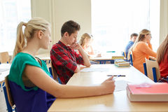Group of students writing school test Stock Photography