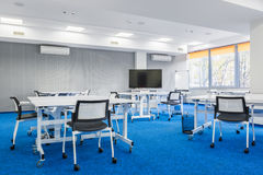 Group study room. Modern group study room in white and blue with desks, chairs and big screen Royalty Free Stock Photos