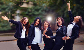 Group of stylish happy women on evening street Stock Photo