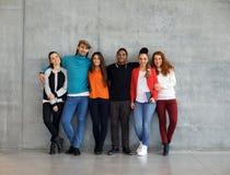 Group of stylish young university students royalty free stock image