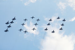 Group of Su-25, MiG-29 and Su-27 featuring digit 100 Stock Photography