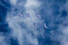 Group su-27 performing aerobatics at an airshow Royalty Free Stock Image