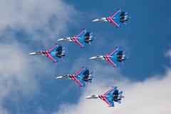 Group su-27 performing aerobatics at an airshow Stock Photo
