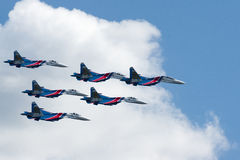 Group su-27 performing aerobatics at an airshow. Samara, Russia - August 22. 2015: Demonstration performances of flight group Falcons of Russia on Su-27. Airshow Stock Image