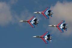 Group su-27 performing aerobatics at an airshow Royalty Free Stock Photos