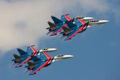 Group su-27 performing aerobatics at an airshow Royalty Free Stock Images