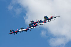 Group su-27 performing aerobatics at an airshow Royalty Free Stock Photo
