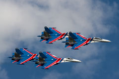 Group su-27 performing aerobatics at an airshow. Samara, Russia - August 22. 2015: Demonstration performances of flight group Falcons of Russia on Su-27. Airshow stock photography