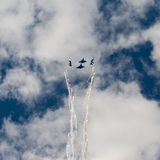 Group su-27 performing aerobatics at an airshow Royalty Free Stock Image