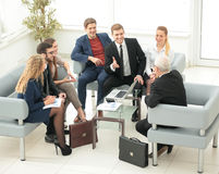 A group of successful business people. Discussion of the importa Stock Photo