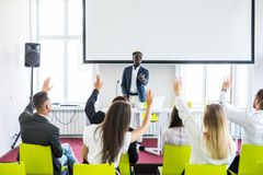 Group of successful business people at the lecture asking questions during team seminar stock photos