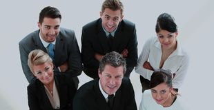 Group of successful business people looking confident. Successful business people looking up and smiling at office Royalty Free Stock Photos