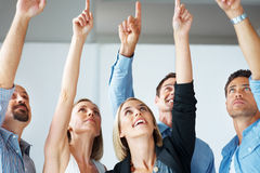 Group of successful business people pointing up Royalty Free Stock Images