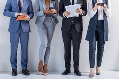 Group of successful business people in suits standing royalty free stock photography