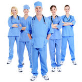 Group of successful laughing surgeons. In blue uniforms - white background Stock Photography