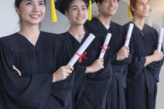 Group of Successful student on their graduation day, graduate holding diploma, Education, Graduation and people concept.  stock photos