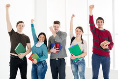 Group Of Successful Students With Books. Stock Photo