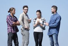 Group of successful students communicating together. Photo with copy space Stock Images