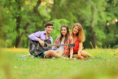 Group of successful students with a guitar resting Stock Photography