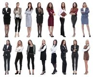 Group of successful young businesswoman standing in a row stock images