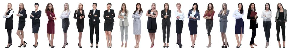 Group of successful young businesswoman standing in a row stock photo