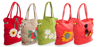 Group of summer beach bag with flowers Royalty Free Stock Photos