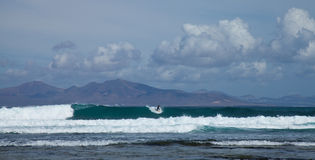 Group of surfers in the sea swell Stock Images