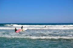 group of surfers surfing inTorremolinos, Costa del Sol, Spain Stock Photography