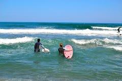 group of surfers surfing inTorremolinos, Costa del Sol, Spain Stock Photos