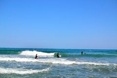 group of surfers surfing inTorremolinos, Costa del Sol, Spain Stock Images