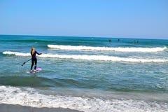 group of surfers surfing inTorremolinos, Costa del Sol, Spain Stock Photo