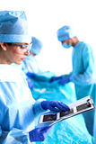 Group of surgeon at work in operating theatre Royalty Free Stock Photography
