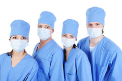 Group of surgeons in medical blue uniform Stock Images