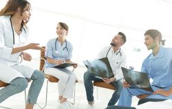 Group of surgeons and medical professional staff discussing on patient radiography stock photography